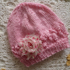 Hand-knitted baby's beanie w diamond border & flower, fits 3 - 9 months, acrylic