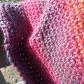 Child's crocheted cap in variegated pink pure wool