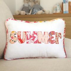 Organic cotton name cushion in modern, fresh peachy-pink colour palette