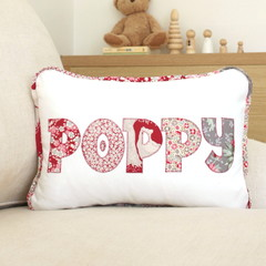 Beautiful name cushion in carmine red woodland florals