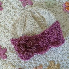 Hand-knitted baby girl's lacy beanie with chiffon flower,  fits 3 – 9 mths