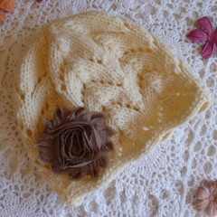 Hand-knitted cosy baby girl's lacy beanie w flower; fits 3 - 9 months