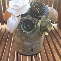 Small handcrafted paper flowers in a plant pot