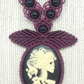 Cherry black macrame necklace with skeleton cameo.