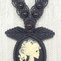 Black macrame necklace with skeleton cameo.