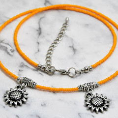 Sunflower, Tibetan Charm Necklace with Orange Seed Beads.