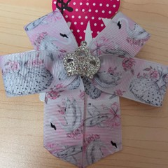 Double looped ballet motif ribbon with embellishment