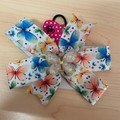 Butterfly pinwheel bow with embellishment