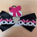 Black bow with pattern ribbon and embellishment.