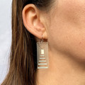 Antipodes stainless steel pendant and earring set