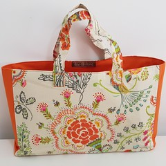 Bright orange and cream bag and zippered box pouch set.