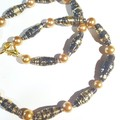 Stunning navy and gold paper bead with gold pearls necklace. One off design