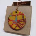"""Orange Stipes"" circle pendant with leather cord"