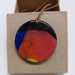 """Into the Fire"" circle pendant with leather cord"