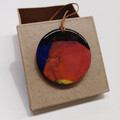 """""""Into the Fire"""" circle pendant with leather cord"""