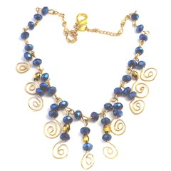 Necklace. Blue and gold crystal with wire coils in gold. Some serious bling.