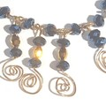 Some serious bling. Blue and gold crystal necklace with wire coils in gold