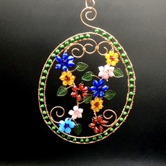 Oval floral glass beaded hanger