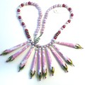 Necklace. Handmade paper beads in pink and white stripes with red wooden beads.