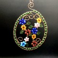 Oval floral glass beaded hanger