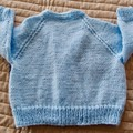 Size 6-12 months: Girls hand knitted cardigan by CuddleCorner