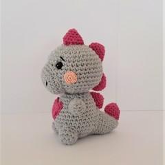 cute, crocheted dinosaur toy