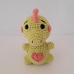 soft, cute, crocheted dinosaur toy