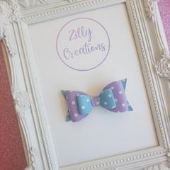purple and blue polka dot hair bow
