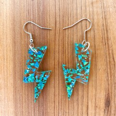 Lightning bolt drop earrings made with teal glitter infused acrylic