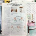 """Plaid book on """"Decorating with Stenciling"""" by Jane Gauss."""