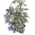 Necklace pendant style with some serious bling in silver & pearls. Flower power