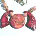 Necklace. Rose Jasper, ceramic beads & swarovski crystals in a Art Deco feature.