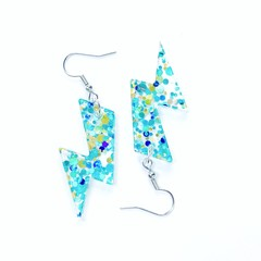 Lightning bolt drop earrings made with blue green and glitter infused acrylic
