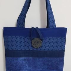 Big royal blue tote bag.