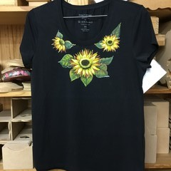 Black tee-shirt hand painted with sunflowers.
