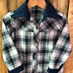 Customized boy's long sleeve shirt in navy and white check.