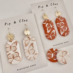 Oval butterfly clay earrings