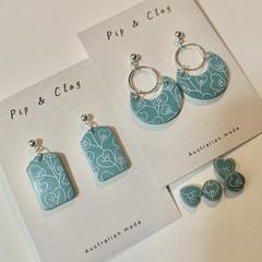Blue floral heart clay earrings
