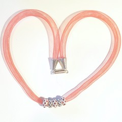 Necklace with pave crystals ring in red and blue. Red nylon tubing necklace.