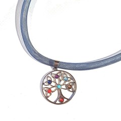 Necklace with tree of life charm in silver with blue, red, & purple stones.