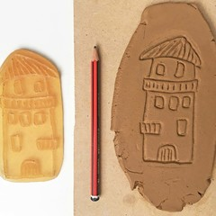 House #1 stamp-mat. Rubber stamp for making impressions in clay.