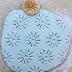 Stamp-Mat #2. Sun-shaped rubber stamp for making impressions in clay.