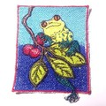Applique. Oh so cute yellow frog sitting on a branch applique.