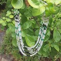 Necklace. Multi strand beads with Swarovski crystal. Clear with black and green