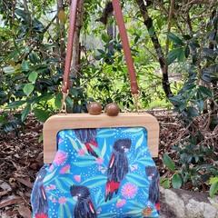 Bright blue handbag with crossbody strap