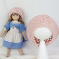 Doll and child matching hats