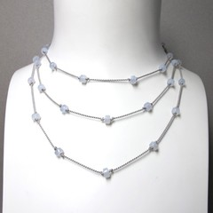 Blue Chalcedony beads on a long flapper style silk necklace