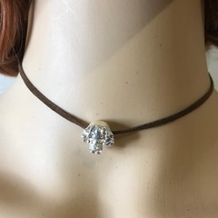 Hermione charm on a fitted brown choker