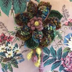 Multi layered deep coloured crochet anemone flower brooch