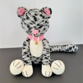 Kitty the cat, a crocheted toy